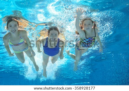 Family swim in pool or sea underwater, happy active mother and children have fun under water, kids sport on family vacation  - stock photo