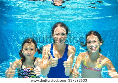 Family swim in pool underwater, happy active mother and children have fun in water, kids sport on family vacation  - stock photo
