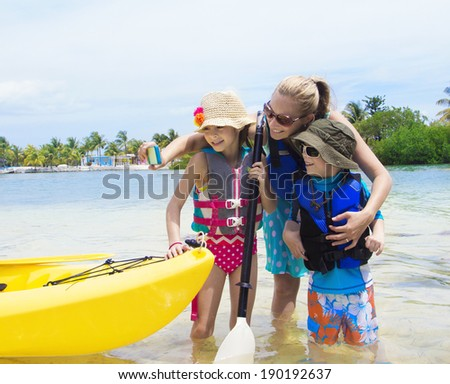 Family taking selfie with smartphone while on vacation - stock photo
