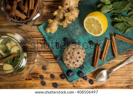 Family tea time, english tradition, sweet cakes, cupcake cinnamon and ginger, blueberries,  fresh mint on wooden table, natural herbal collections, 5 o'clock, closeup food photo - stock photo