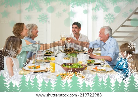 Family toasting while having meal against snowflakes and fir trees in green - stock photo