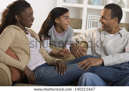 Family together in living room - stock photo