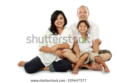 family together sitting on white background - stock photo