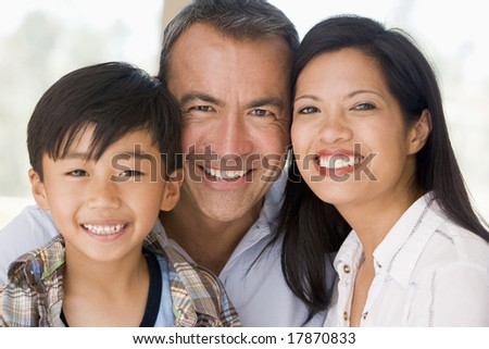 Family together smiling - stock photo