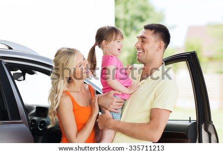 family, transport, leisure and people concept - happy man, woman and little girl with car laughing at home parking space - stock photo