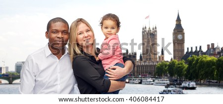 family, travel, tourism and international concept - happy multiracial mother, father and little child over london city background - stock photo