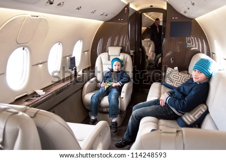 Family Traveling by Commercial Airplane - stock photo