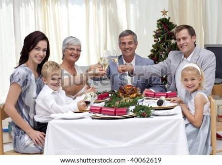 Family tusting in a Christmas dinner at home - stock photo