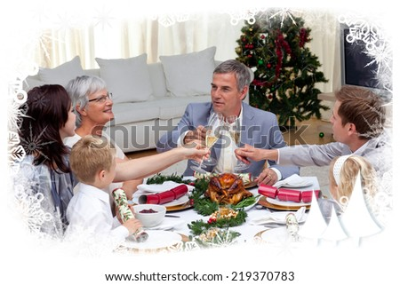 Family tusting in a Christmas dinner with champagne against frost frame - stock photo
