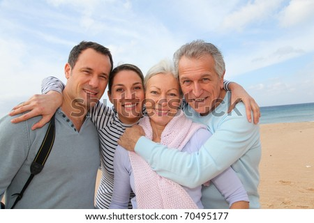 Family vacation at the beach - stock photo