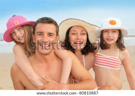 Family vacation at the beach - stock photo