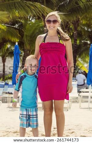 Family vacation fun at a tropical resort - stock photo