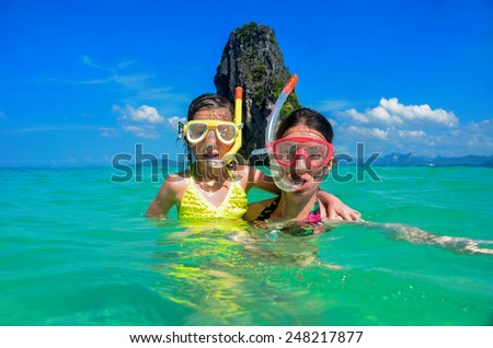 Family vacation, mother and kid snorkeling in sea in Thailand  - stock photo