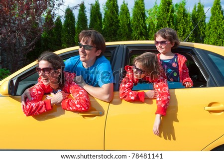 Family vacation. Parents with two kids having car trip - stock photo
