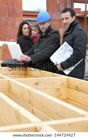 Family visiting site of their future home - stock photo