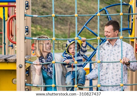 Family walk in the park - stock photo