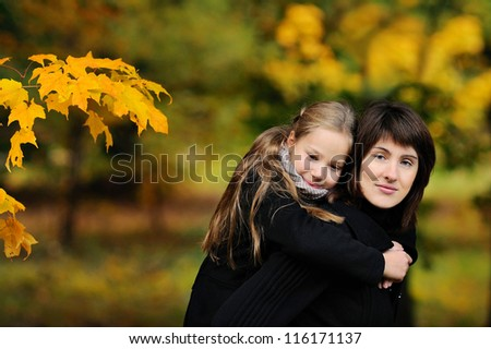 family walking in autumn park - stock photo