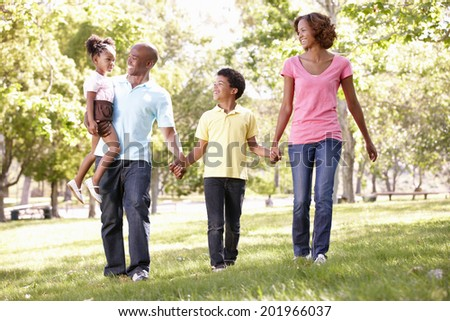 Family walking in park - stock photo