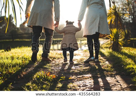 family walking together - stock photo
