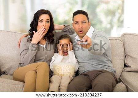 family watching scary movies at home - stock photo