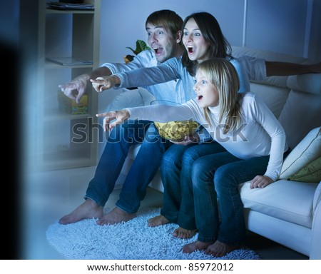 Family watching TV .True Emotions - stock photo