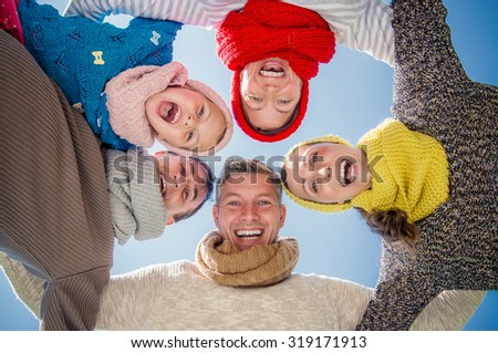 family winter colder season group  - stock photo