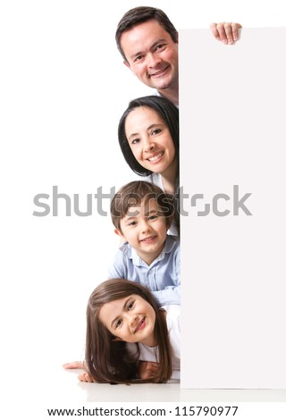 Family with a banner smiling - isolated over a white background - stock photo