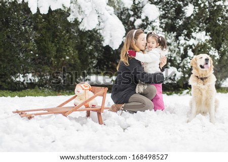 Family with a dog at winter - stock photo