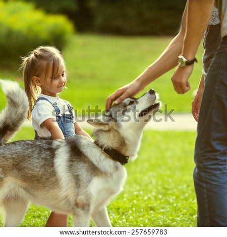 family with a dog in the park - stock photo