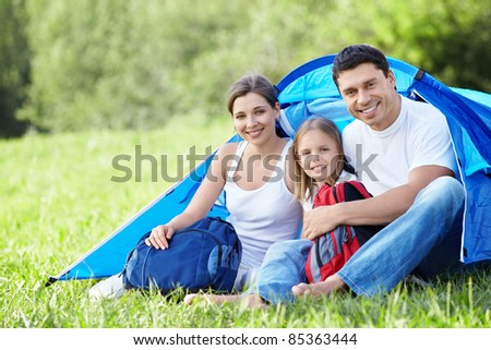 Family with baby outdoors - stock photo