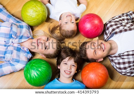 Family with bowling ball - stock photo