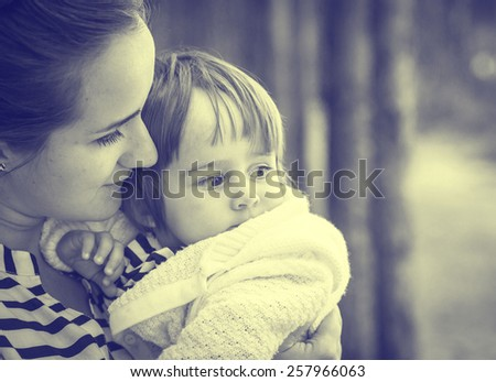 Family with child  and mother in same stripes clothes vintage black and white nature - stock photo