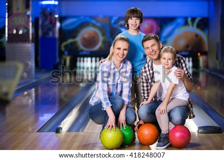 Family with children in bowling - stock photo