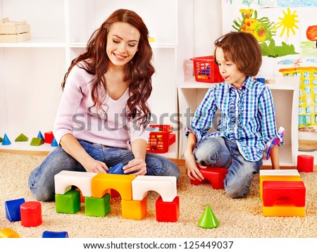 Family with children playing bricks. - stock photo