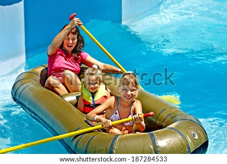 Family with children  ride  rubber boat at  swimming pool . - stock photo