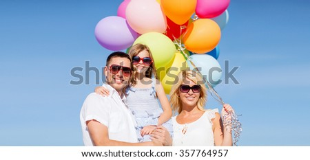 family with colorful balloons - stock photo