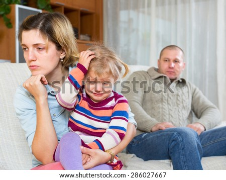 Family with crying child having serious conflict at home - stock photo