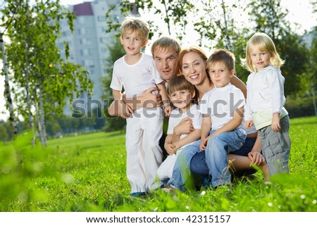 Family with four children in a summer garden - stock photo