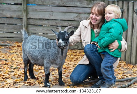 family with goat - stock photo