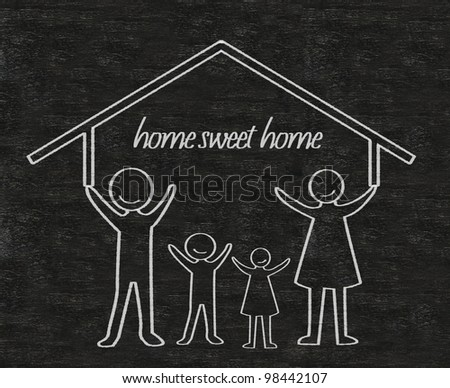 family with house home sweet home written on blackboard background high resolution - stock photo