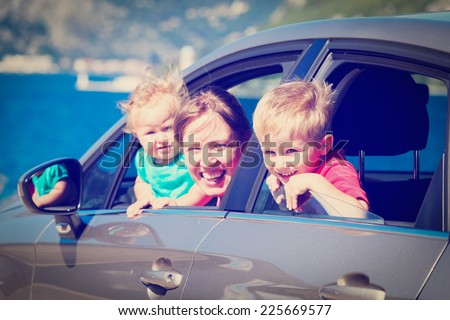 family with kids travel by car on sea vacation - stock photo