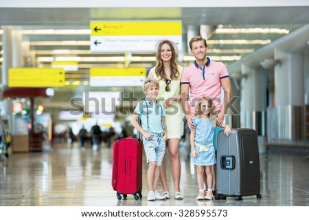 Family with luggage at the airport - stock photo