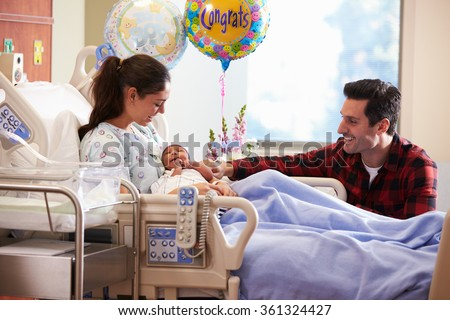 Family With New Born Baby In Post Natal Hospital Department - stock photo