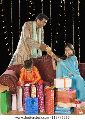 Family with shopping bags and gifts on Diwali festival - stock photo
