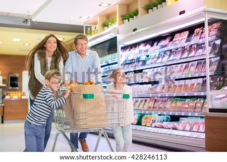 Family with shopping cart - stock photo