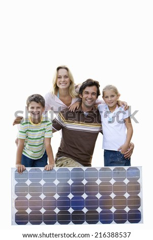 Family with solar panel, smiling, portrait, cut out - stock photo