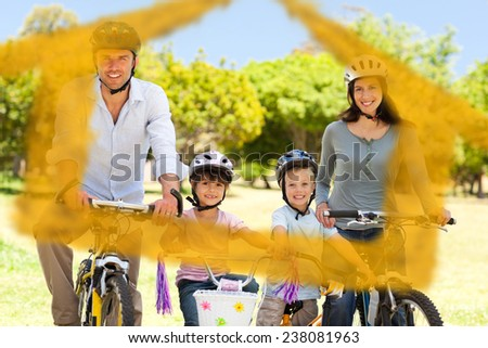 Family with their bikes against house outline in clouds - stock photo