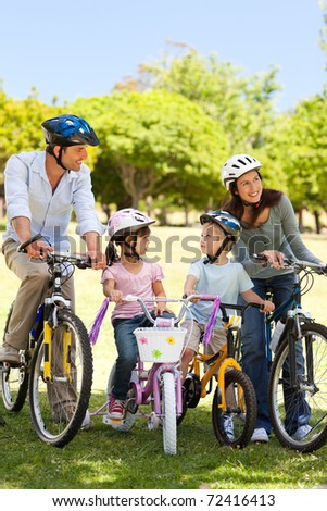 Family with their bikes in the park - stock photo