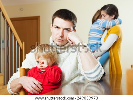 Family with two children after quarrel in home - stock photo