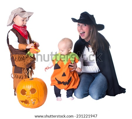 Family with two children in costume on Halloween - stock photo